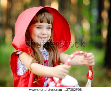 "girl in the wood with a basket in hands. the fairy tale "" Red Riding Hood"""