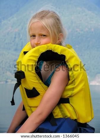 Girl in the yellow air-jacket on Altai lake Teletskoe