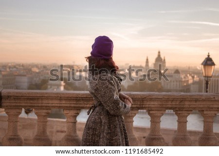 girl in vintage outfit watching the sunrise in Budapest, Hungary
