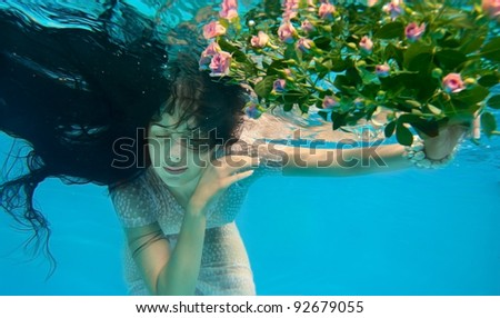 Girl in water with flowers