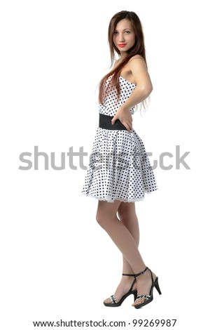 Girl in white dress in black polka dots, isolated on white - stock photo