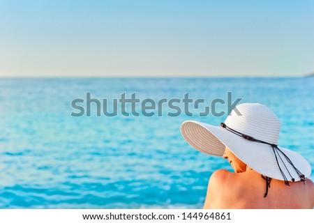 girl in white hat on the beach sunbathing #144964861