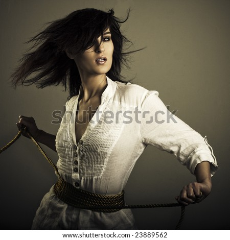 girl in wind with golden rope