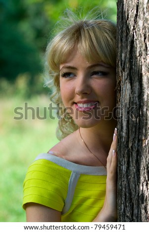 Girl in yellow blouse with smile.