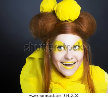 Girl in yellow. Portrait of young happy woman in artistic image.