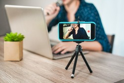 Girl influencer girl preparing video set while creating social media contents - Young woman having fun with technology trends - New smart working concept - Focus on face inside phone screen