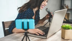Girl influencer preparing video set while creating social media contents - Young woman having fun with technology trends - New smart working concept - Focus on face