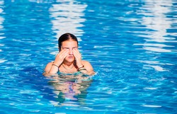 girl is afraid have allergy on chlorine disinfection in water