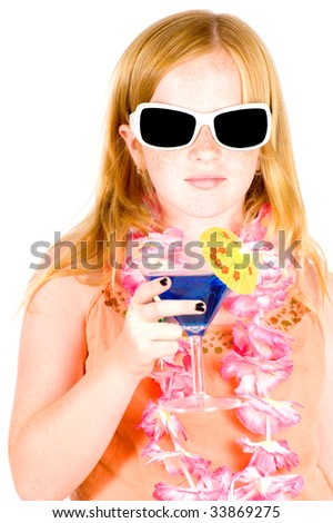 girl is drinking a blue cocktail wearing sunglasses isolated on white