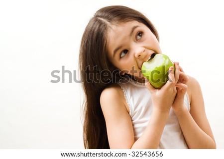 Girl is eating apple