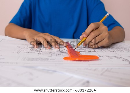 Girl is engineer show. And is studying his father's drawing equipment. #688172284