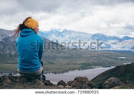 Girl is enjoying  the landscape at Denali National Park, Alaska