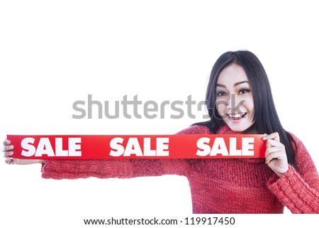 Girl is holding banner of sale during winter season, isolated in white