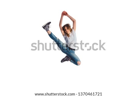 Girl is jumping in isolated room while doing aerobic moves