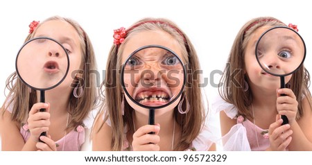 girl is playing with magnify glass (kiss, eye, dentist visit)