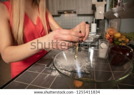 girl is preparing sweets for Christmas, putting eggs, close up