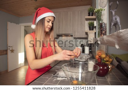 girl is preparing sweets for Christmas, putting eggs in