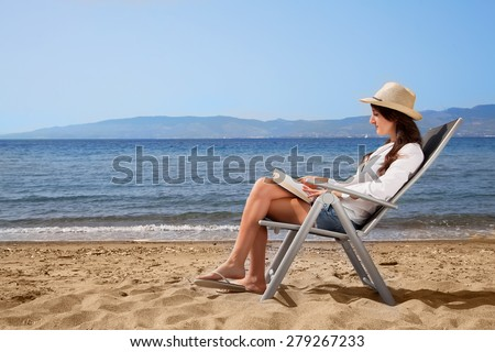 stock-photo-girl-is-reading-a-book-at-the-seaside-279267233.jpg