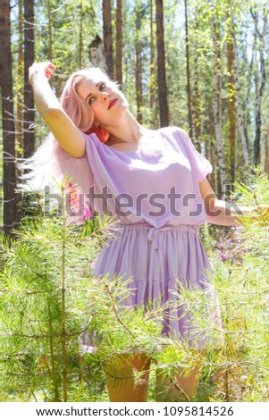 girl is walking in a summer forest #1095814526