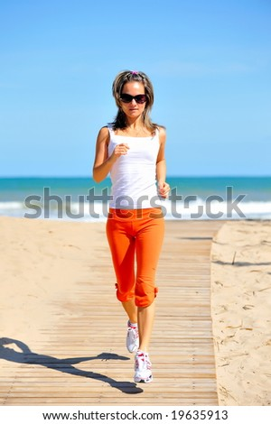 girl jogging on the beach