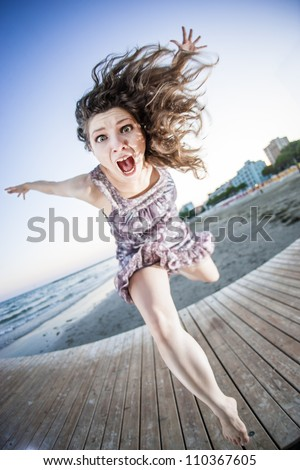Girl jumping like an explosion