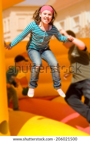Girl jumping on the bouncy castle