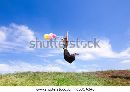 girl jumps from balloons