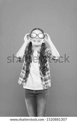 Girl kid wear eyeglasses. Optics and eyesight treatment. Effective exercise eyes zooming. Child happy with good eyesight. Eyesight and eye health. Improve eyesight. Sunglasses fancy accessory.