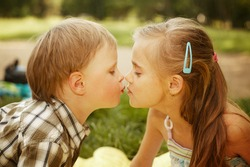 girl kissing a boy