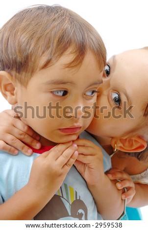 Girl kissing a boy crying . . .