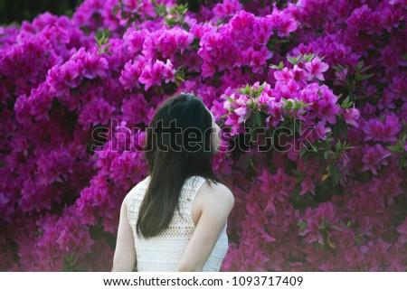 Girl kissing a flower #1093717409
