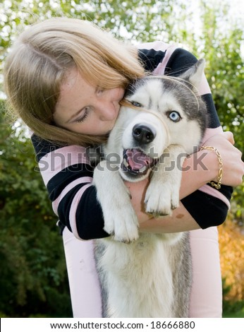girl kissing her dog