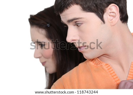 Girl laughing at boy