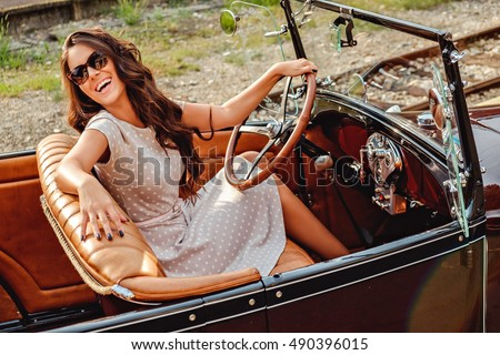 girl laughing while driving old ...