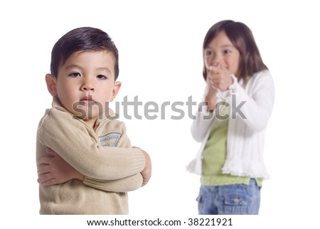 Girl laughs at younger brother who shows his displeasure.