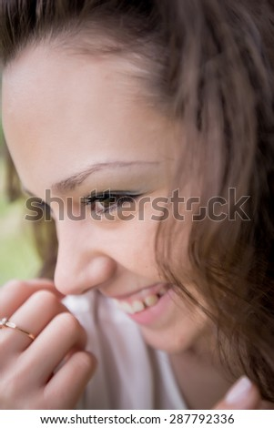 Girl laughs. Closeup of smiling young woman on open air #287792336