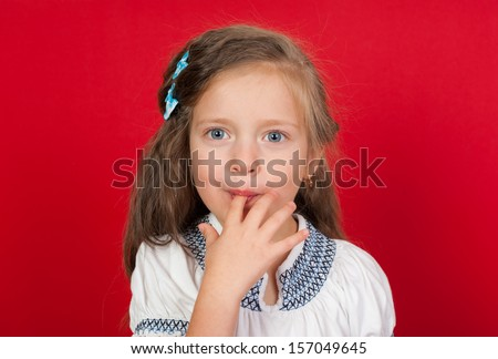 girl licking her fingers