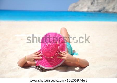 girl lies on a paradise beach #1020597463