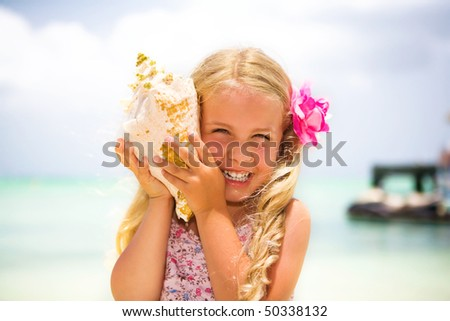 girl listening to a seashell