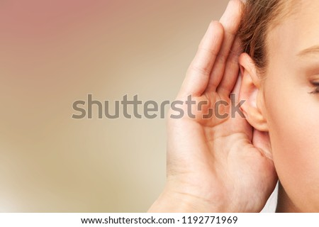 Girl listening with her hand on an