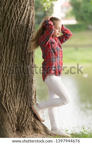 Girl little cute child enjoy walk on windy day nature background. Hairstyles to wear on windy days. Feeling cozy and comfortable on windy day. Deal with long hair on windy day. Windproof hairstyles.