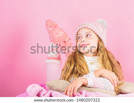 Girl long hair dream pink background. Kid dreamy face wear knitted accessory. Kid girl wear cute knitted fashionable hat and scarf accessory. Winter fashion accessory. Winter accessory concept.
