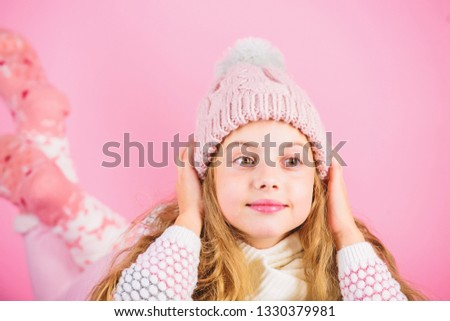 Girl long hair dream pink background. Kid dreamy face wear knitted accessory. Winter fashion accessory. Kid girl wear cute knitted fashionable hat and scarf accessory. Winter accessory concept.
