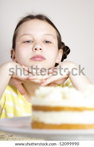 girl looking at cake