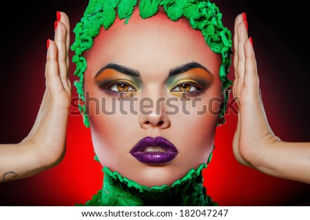 Girl looking at camera with creative makeup in studio