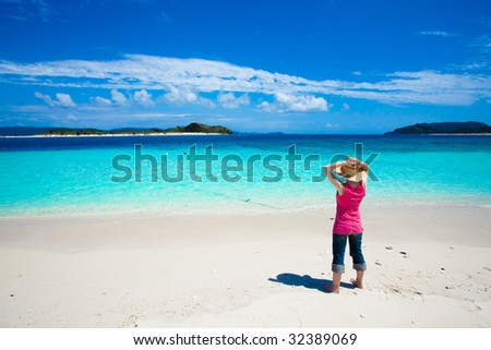 Girl looking at deserted islands on horizon