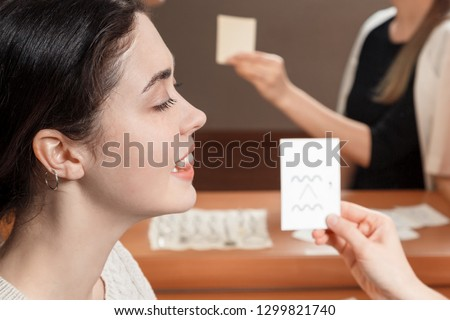 girl looking at the card says sounds. #1299821740