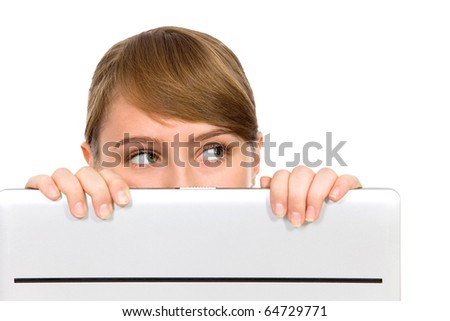 Girl Looking Behind Laptop - stock photo