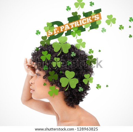 Girl looking into distance with shamrocks coming from her hair and st patricks day greeting