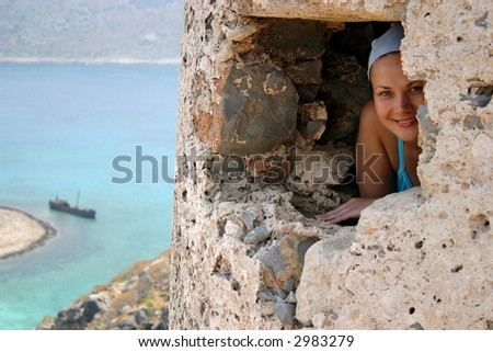 girl looking out a window of an old fortress